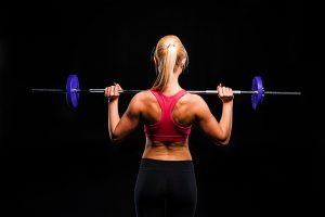 woman lifting small amount of weight