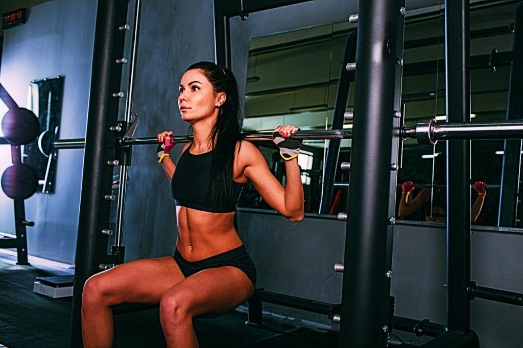 female using smith machine for squats